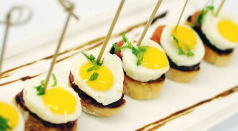 Quail eggs on browned potato slices